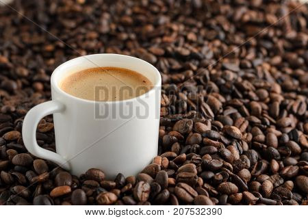coffee cup espresso on background from cofee beans with copy space.