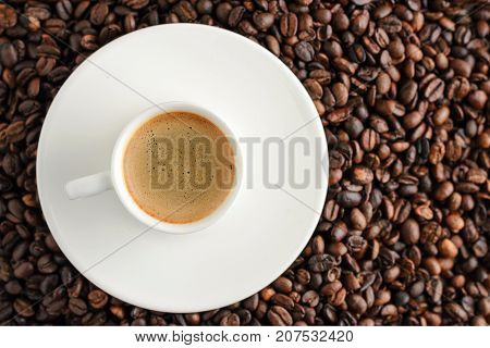 coffee cup espresso on background from cofee beans with copy space. top view