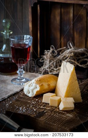 Cheese, Dread And Red Wine On A Wooden Background, Rustic Style