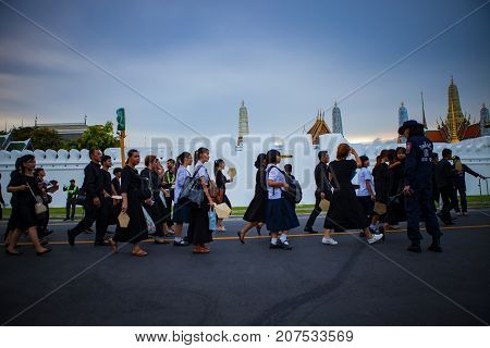 BANGKOK THAILAND - OCTOBER 52017 : thai mourners people wearing black clothes on last day of respect to their beloved king bhumibol adulyadejat at grand palace