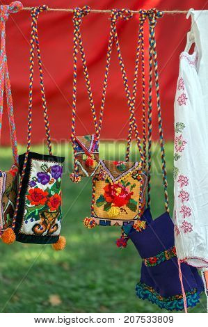 Background with bags embroidered and decorated with specific patterns of the Bistrita-Nasaud area Romania exposed for sale.