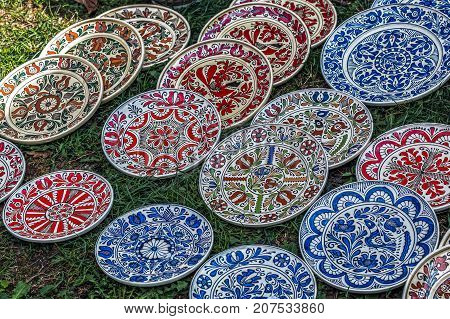 Romanian traditional ceramic in the plates form painted with specific patterns for Corund Transylvania area.
