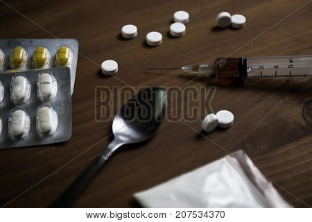 Man Substance Dependence Medication Drug Syringe And Cooked Heroin