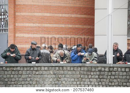 KIEV (KYIV), UKRAINE,November 11,2013: Charity. Homeless people eat a free lunch