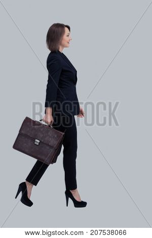 Profile of walking businesswoman with suitcase, isolated on whit