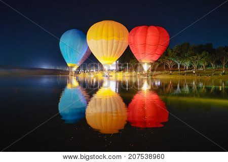 Hot air balloon glow reflected in the water