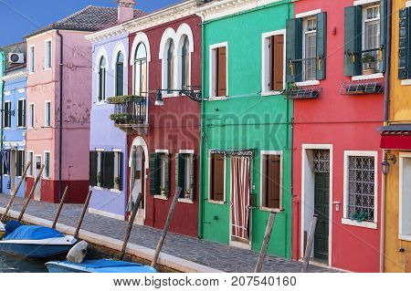 Colorful small brightly painted houses on the island of Burano Venice Italy. Burano is an island in the Venetian Lagoon situated 7 kilometers from Venice