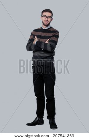 Full length of a business man with crossed arms isolated on whit