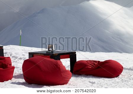 Bean Bag Chairs And Table In Outdoor Cafe At Ski Resort