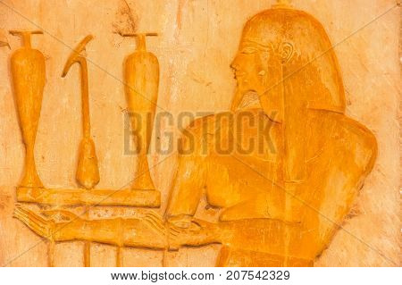 Egyptian relief. Egyptian hieroglyphics carved in stone. Ruins