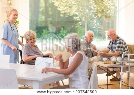 Seniors In Living Room
