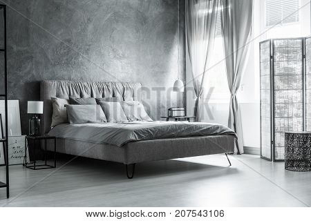 Dark Bedroom With Decorative Curtains