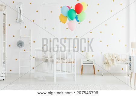 Colorful Balloons Above Baby's Bed