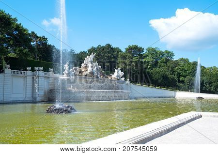Vienna Austria - August 7 2016: The Neptune fountain in the garden of the Schonbrunn Palace