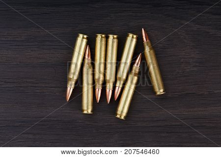 Old Ammunition On The Wood Background. Army Equipment.