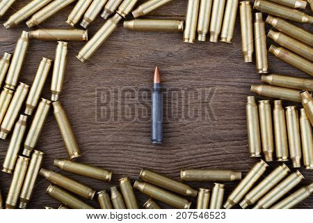 Ak-47 Cartridges On Wooden Table Close-up.
