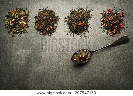 Dry Tea collection of different types on gray background