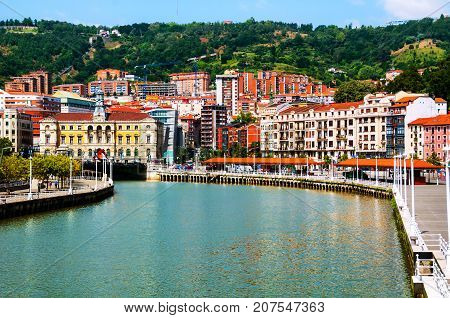 Bilbao, Spain. City downtown with a Nevion River and promenade area in Bilbao, Spain during the sunny day