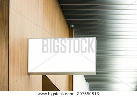 Horizontal rectangular white empty signage mock up of store, shop in shopping mall