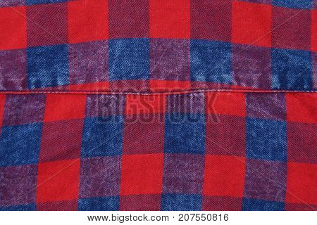 Red and blue lumberjack pattern with seam