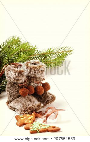Winter boots with christmas tree and gingerbread cookies, retro toned