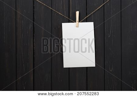 Blank White Paper Card Hanging On Clothespins