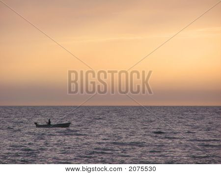 Lone Fisherman At Dusk