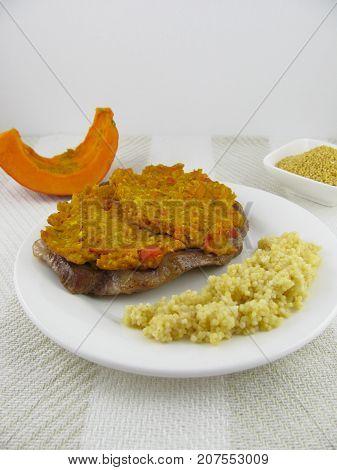 Tasty pork neck steak with pumpkin crust