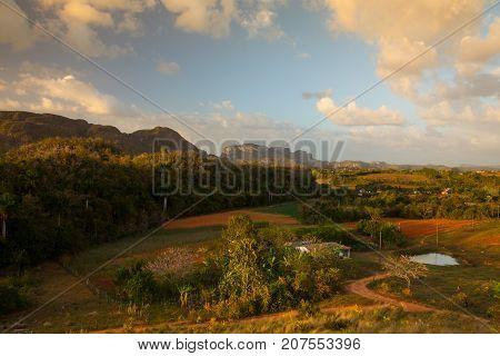Famous Cuba farmland tobacco area at sunset Valley de Vinales Pinar del Rio Cuba.