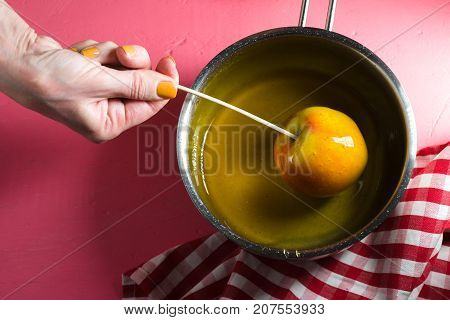 Cooking caramel apple for Thanksgiving holiday free space horizontal