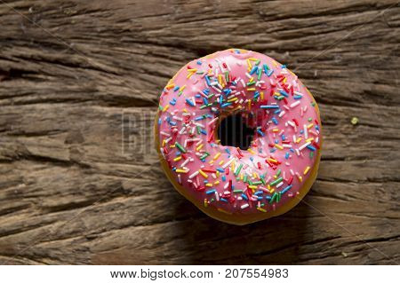 unhealthy but delicious sweet sugar donut cake on vintage wooden table in lifestyle nutrition health care and calories abuse and dieting concept