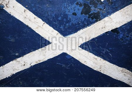 The Flag of Scotland painted in the hull of a ship; Concept for travel in Scotland