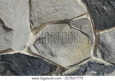 Dark grey black stoun for background.Rock wall texture.
