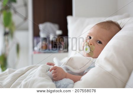 Cute Baby Boy, Lying In Bed With Cold
