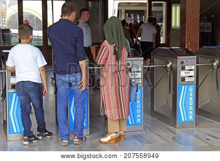 People Are Passing Through Wicket To Ferry In Istanbul