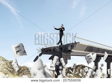 Businessman walking blindfolded among flying documents on concrete bridge with huge gap as symbol of hidden threats and risks. Skyscape and nature view on background. 3D rendering.