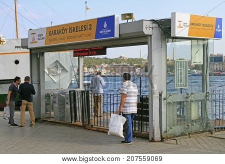People Are Passing Through Wicket To Ferry In Istanbul, Turkey