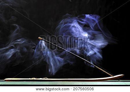 Aromatic stick smoldering and emits intense smoke
