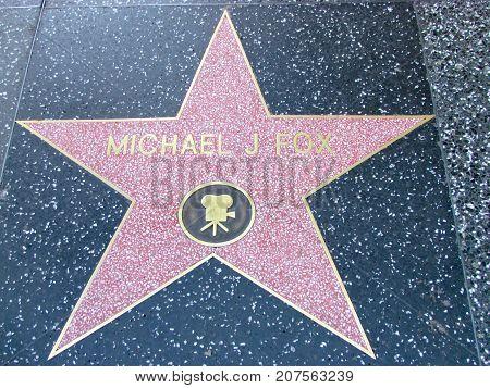 Los Angeles California USA, 10 February 2011: Actor Michael J Fox star on Hollywood boulevard walk of fame in LA