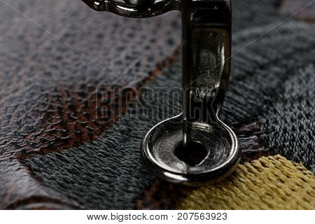 Multilayer embroidery on brown leatherette with embroidery machine - macro