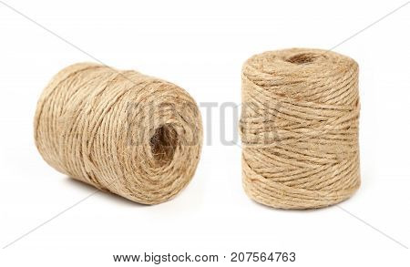 Two Coil Bobbins Of Burlap Jute Twine Over White