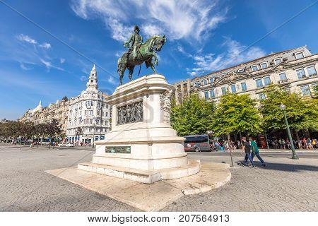 Porto, Portugal - August 11, 2017: equestrian bronze statue of king Dom Pedro IV at Praca da Liberdade or Freedom Square in Avenidas dos Alidaos, Oporto historic center in a sunny day.