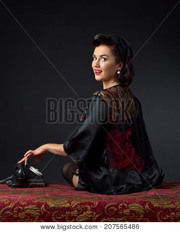 Beautiful Woman With Vintage Phone.