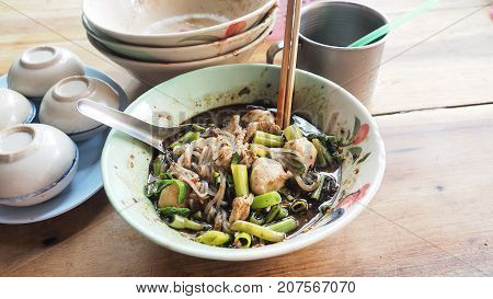 Boat noodles beef super spicy to clenching ready to eat The soup is blood also contains nam tok are commonly served with ice in stainless cup and Steamed Pandanus Cake