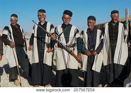 CIRCA ISFAHAN, IRAN - JUNE 22, 2007: Unidentified Bakhtiari nomad tribe men wear traditional dresses circa Isfahan, Iran. Some Bakhtiari people in Iran still follow nomadic lifestyle live in tents and wear traditional dress daily.