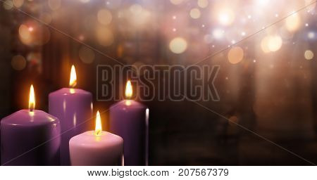 Advent Candles In Church - Three Purple And One Pink As A Catholic Symbol And Bokeh Lights