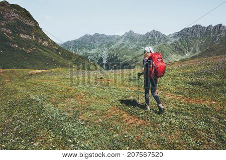 Woman traveler with backpack hiking at mountains Travel Lifestyle wanderlust adventure concept summer vacations outdoor into the wild landscape