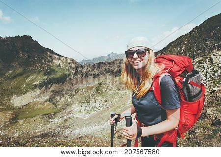Happy woman hiking with backpack at mountains landscape Travel Lifestyle wanderlust adventure concept summer vacations outdoor into the wild