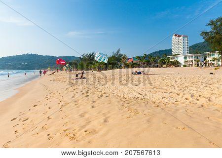 PHUKET THAILAND - APRIL 17: People rest at the Karon Beach on April 17 2016 in Phuket Thailand