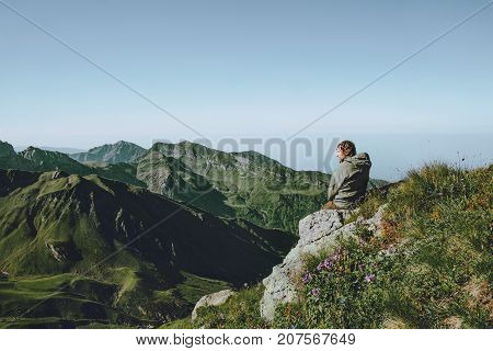 Man hiker alone at mountains enjoying landscape aerial view Travel Lifestyle concept adventure vacations outdoor